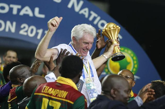 Football Soccer - African Cup of Nations - Final - Egypt v Cameroon - Stade d'Angondjé - Libreville, Gabon - 5/2/17 Cameroon coach Hugo Broos celebrates with the trophy and teammates after winning the African Cup of Nations Reuters / Amr Abdallah Dalsh Livepic