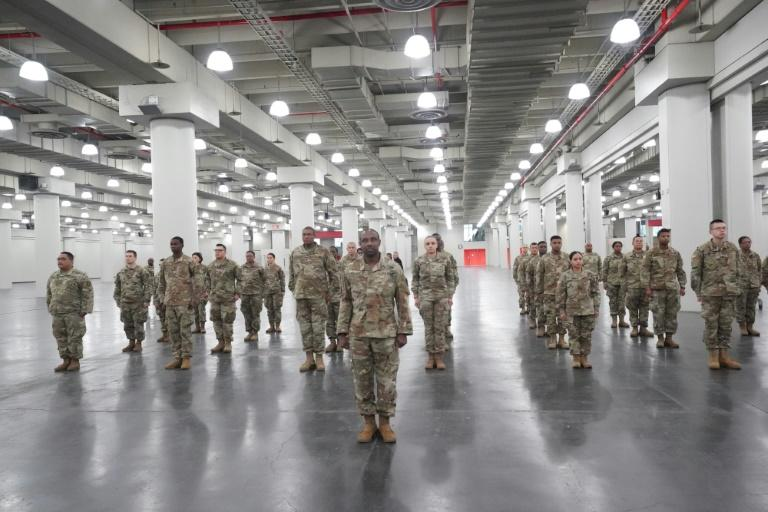 Members of the Army National Guard deploy at New York's Jacob Javits Center as New York Governor Andrew Cuomo announces plans to convert the center into a field hospital