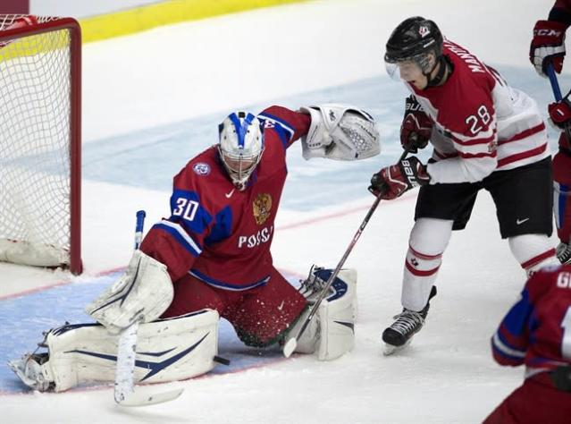 Russia goaltender Andrei Vasilevski makes a save on Canada forward Anthony Mantha duirng first period bronze medal game action at the IIHF World Junior Hockey Championships in Malmo, Sweden on Sunday, January 5, 2014. THE CANADIAN PRESS/ Frank Gunn