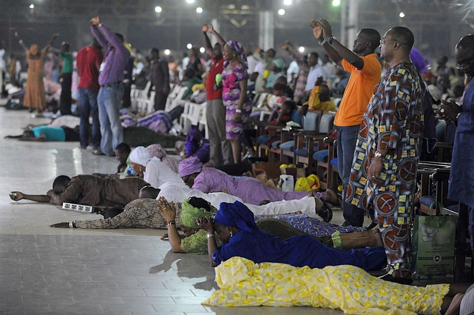 "<span class=""caption"">Pentacostalism is the fast growing movement in Africa. This image shows worshippers in Nigeria.</span> <span class=""attribution""><a class=""link rapid-noclick-resp"" href=""https://www.gettyimages.com/detail/news-photo/worshippers-pray-into-the-new-year-lying-down-during-the-news-photo/459883839?adppopup=true"" rel=""nofollow noopener"" target=""_blank"" data-ylk=""slk:PIUS UTOMI EKPEI/AFP via Getty Images"">PIUS UTOMI EKPEI/AFP via Getty Images</a></span>"