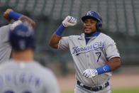 Kansas City Royals' Maikel Franco is greeted at home plate after his three-run home run during the fourth inning of a baseball game against the Detroit Tigers, Monday, July 27, 2020, in Detroit. (AP Photo/Carlos Osorio)