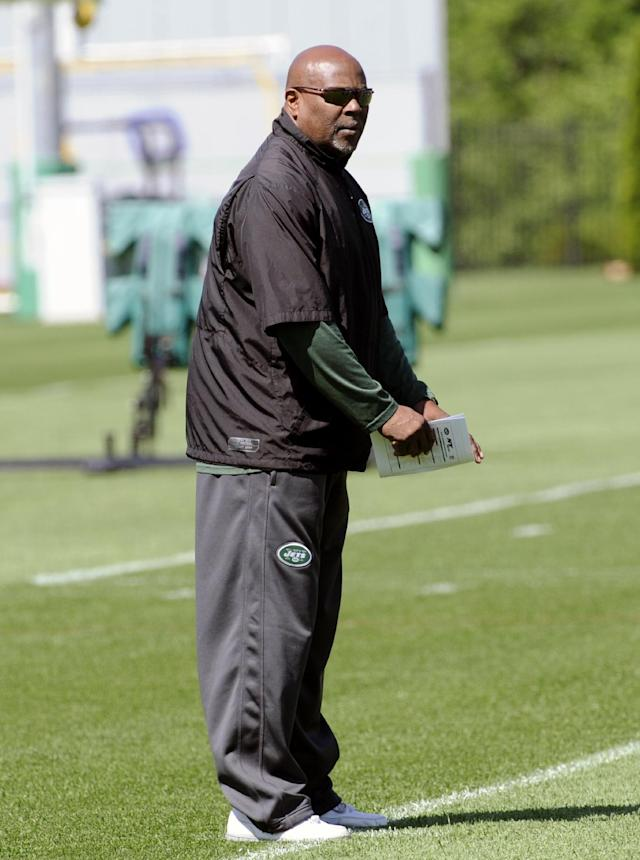 New York Jets defensive coordinator Dennis Thurman looks on during NFL football rookie camp on Saturday, May 17, 2014, in Florham Park, N.J. (AP Photo/Bill Kostroun)