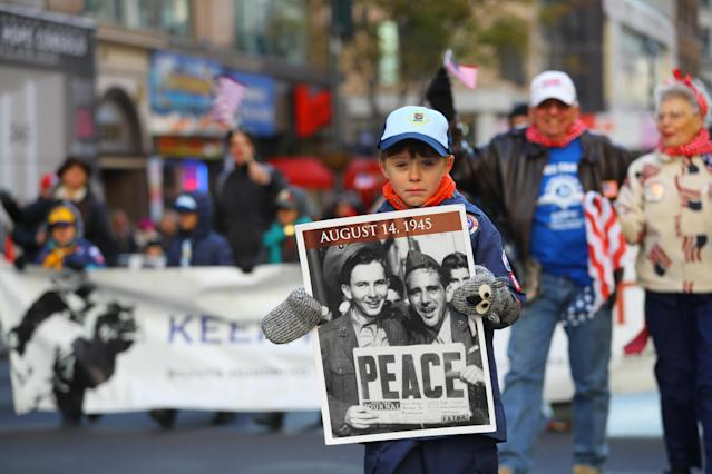 "<p>A young marchers holds up a sign saying ""Peace"" during the Veterans Day parade on Fifth Avenue in New York on Nov. 11, 2017. (Photo: Gordon Donovan/Yahoo News) </p>"