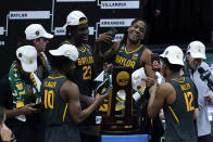Baylor players celebrate with the trophy at the end of the championship game against Gonzaga in the men's Final Four NCAA college basketball tournament, Monday, April 5, 2021, at Lucas Oil Stadium in Indianapolis. Baylor won 86-70. (AP Photo/Michael Conroy)