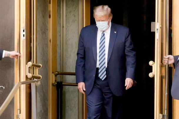 PHOTO: President Donald Trump walks out the front doors of Walter Reed National Military Medical Center to return to the White House, Oct. 5, 2020. (Jonathan Ernst/Reuters)