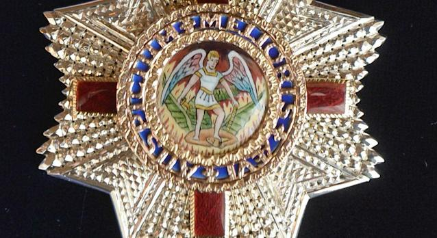 One side of the Order of St Michael and St George. (PA)