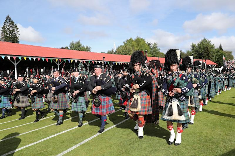 A piped band playing at the 2019 Braemar Highland Games.
