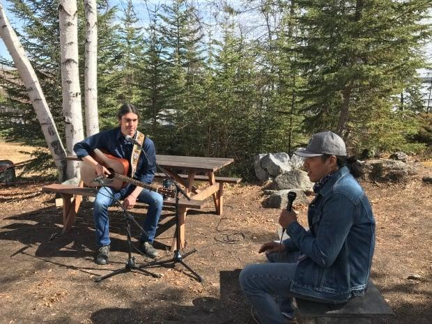 Gilday speaks to Lawrence Nayally, host of CBC's Trail's End, on the shores of Yellowknife's Back Bay.