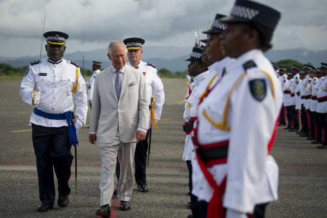 The Prince of Wales inspects the guard at Honiara International Airport in Honiara. (Getty)
