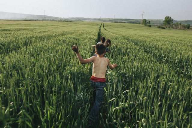 "<p>Children run in the wheat field and enjoy nice weather during the local traditional spring festival, Kirklareli, Turkey, 2017. ""The cold winter leaves the Thrace region of Turkey and welcomes spring with its shining sun and warm winds. People connect again to nature by celebrating it every year during the first week of May in Kirklareli. When I shot this photo, I was running in the wheat field and enjoying the nice weather, remembering my childhood memories with these kids. For them, as for me, it was a moment of pure freedom."" (© Emin Özmen/Magnum Photos) </p>"