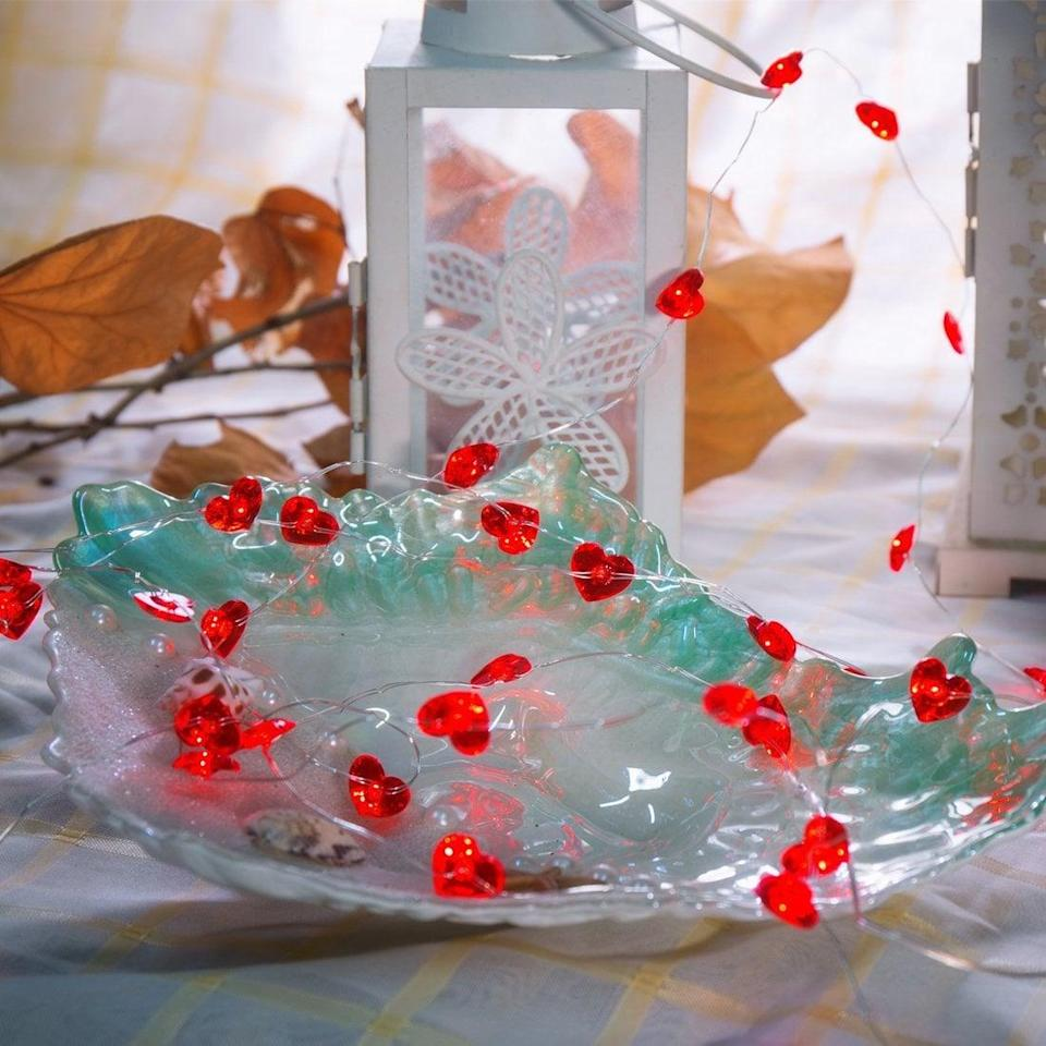 <p>String these <span>Red Heart Lights</span> ($13) along your windows.</p>