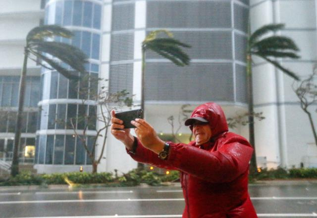 <p><strong>Miami</strong><br>A person photographs the fierce winds with his mobile phone as the full effects of Hurricane Irma strike in Miami, Fla., Sept. 10, 2017. (Photo: Erik S. Lesser/EPA-EFE/REX/Shutterstock) </p>