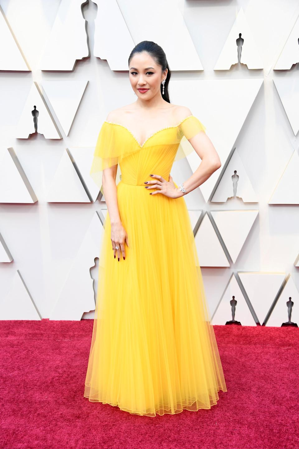 """<p>The """"Crazy Rich Asians"""" opted for a pop of colour in this bright canary gown by Versace. </p>"""