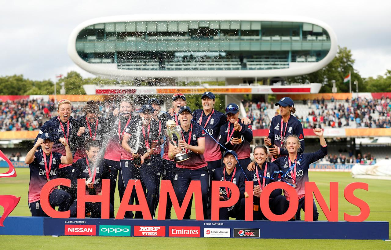 Cricket - Women's Cricket World Cup Final - England vs India - London, Britain - July 23, 2017   England players celebrate winning the world cup with the tophy and spraying sparkling wine   Action Images via Reuters/John Sibley     TPX IMAGES OF THE DAY
