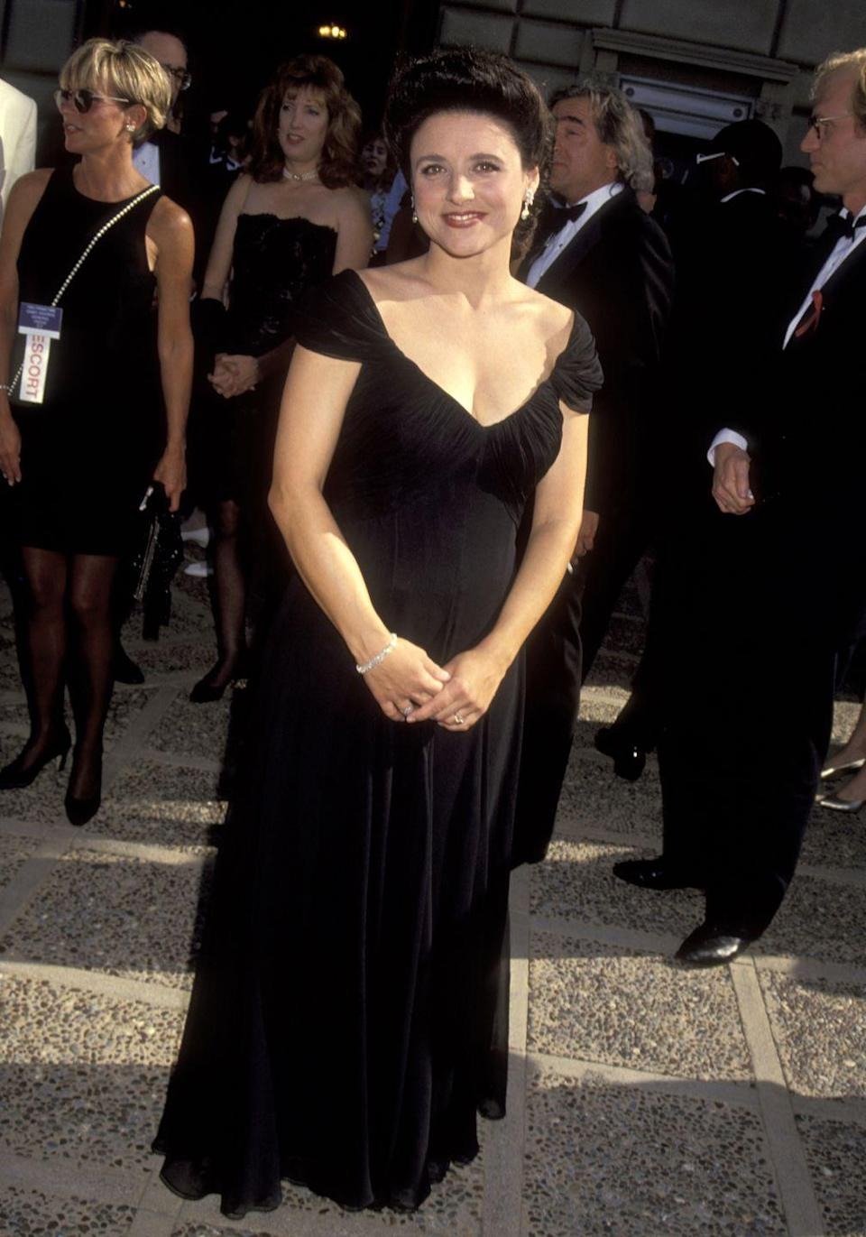 """<p>The <em>Veep</em><span class=""""redactor-invisible-space""""> star wore this black dress to the Emmy Awards in 1992 when she was nominated for <em>Seinfeld</em>. </span></p>"""
