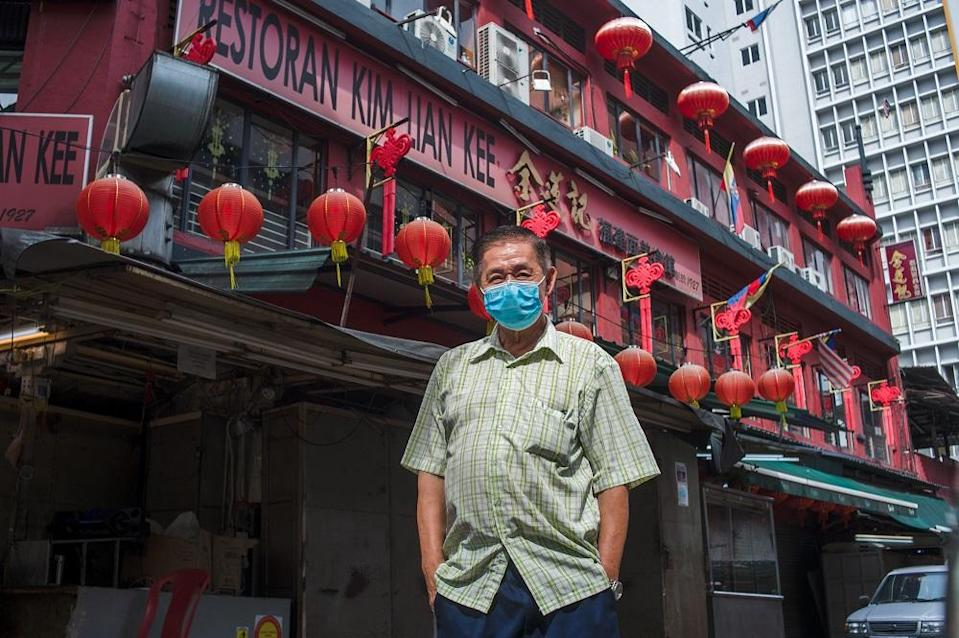 Lee Heng Chuan, owner of Kim Lian Kee restaurant which has been operating since 1927. Seen in the backdrop is the shoplot unit owned by his restaurant. ― Picture by Shafwan Zaidon