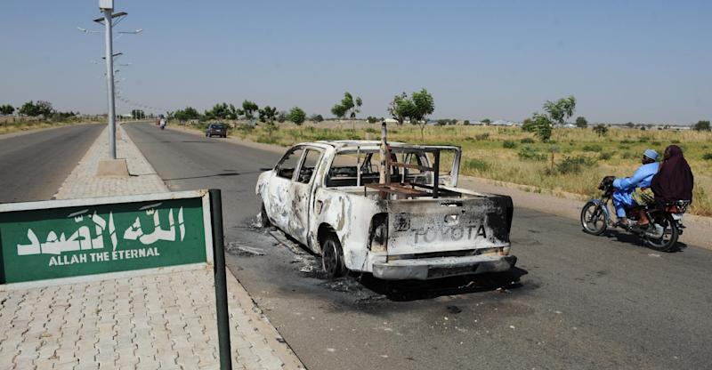 A burnt police patrol pick-up truck on the side of a road in Damaturu, in Yobe State (AFP Photo/Pius Utomi Ekpei)
