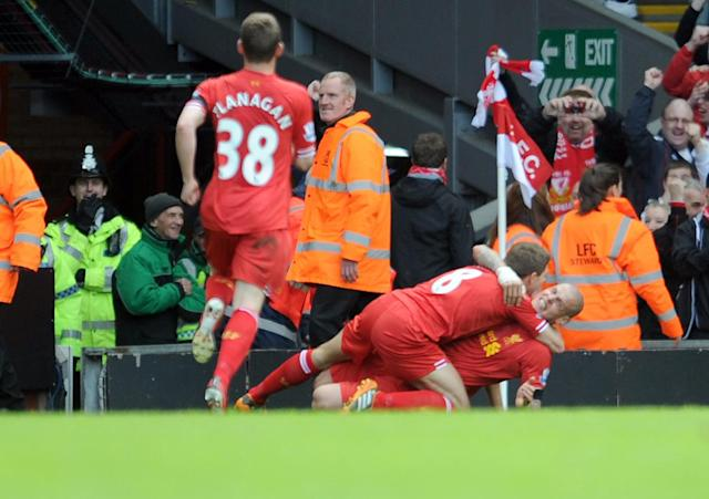 Liverpool's Martin Skrtel right, celebrates with team-mate Steven Gerrard after he scores the second goal of the game for his side during their English Premier League soccer match against Manchester City at Anfield in Liverpool, England, Sunday April. 13, 2014. (AP Photo/Clint Hughes)