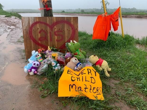 A memorial beside the Shubenacadie River was set up in May to remember the 215 children whose remains were discovered buried at the site of the former Kamloops Indian Residential School. (Shaina Luck/CBC - image credit)