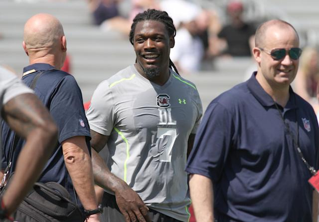South Carolina defensive end Jadeveon Clowney, center, talks during South Carolina's pro day in Columbia, S.C., Wednesday, April 2, 2014. (AP Photo/Mary Ann Chastain)