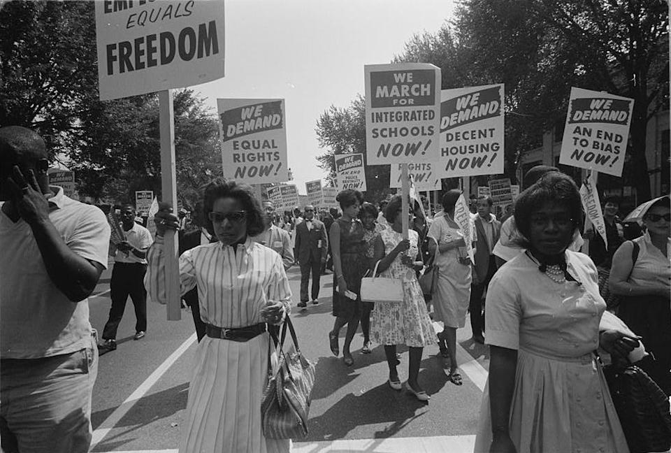 A procession of protesters carrying signs for equal rights, integrated schools, decent housing, and an end to bias in Washington, D.C., on Aug. 28, 1963. (Warren K. Leffler / Library of Congress)