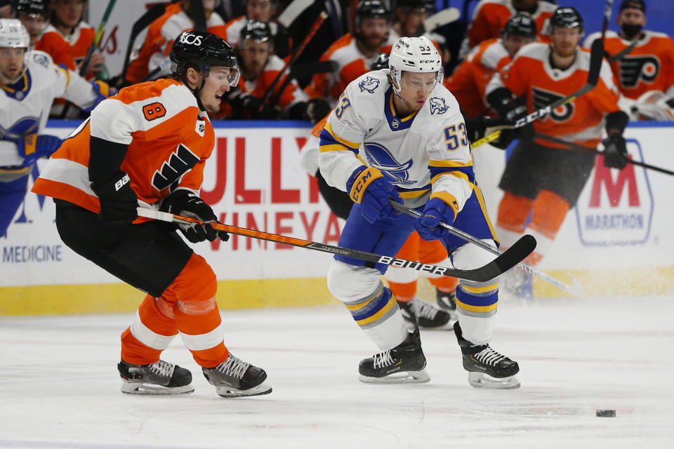 Buffalo Sabres forward Jeff Skinner (53) and Philadelphia Flyers defenseman Robert Hagg (8) battle for the puck during the second period of an NHL hockey game, Saturday, Feb. 27, 2021, in Buffalo, N.Y. (AP Photo/Jeffrey T. Barnes)