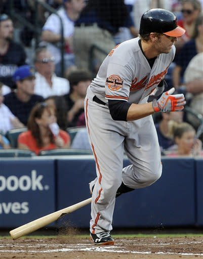 Baltimore Orioles' Mark Reynolds knocks in two runs with a line-drive single to left field against the Atlanta Braves during the fourth inning of a baseball game on Saturday, June 16, 2012, in Atlanta. (AP Photo/John Amis)