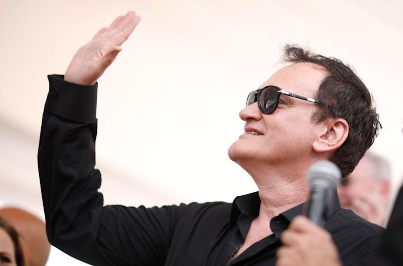 Director Quentin Tarantino poses for photographers at the photo call for the palm dog competition at the 72nd international film festival, Cannes, southern France, Friday, May 24, 2019. (AP Photo/Petros Giannakouris)