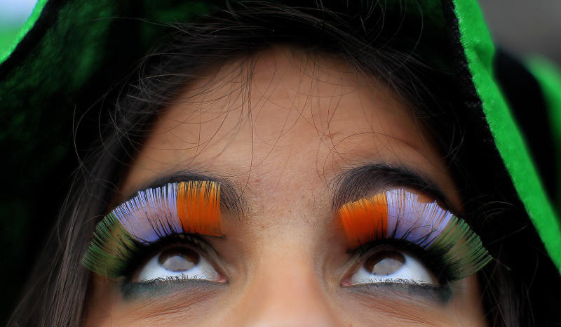 A woman wears false flag eyelashes during the St Patrick's day parade through Dublin city centre on St Patrick's day, Sunday March 17, 2013. (AP Photo/PA, Julien Behal)UNITED KINGDOM AND ALL IRELAND OUT