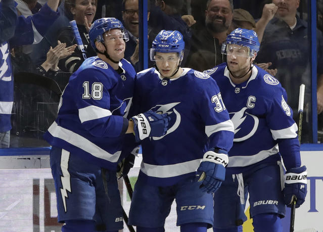 Tampa Bay Lightning center Yanni Gourde (37) celebrates his goal against the Winnipeg Jets with left wing Ondrej Palat (18) and center Steven Stamkos (91) during the first period of an NHL hockey game Tuesday, March 5, 2019, in Tampa, Fla. (AP Photo/Chris O'Meara)