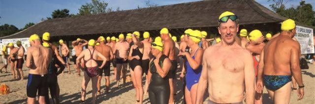 Bruce at a swimming competition (where all participants wore the same caps).