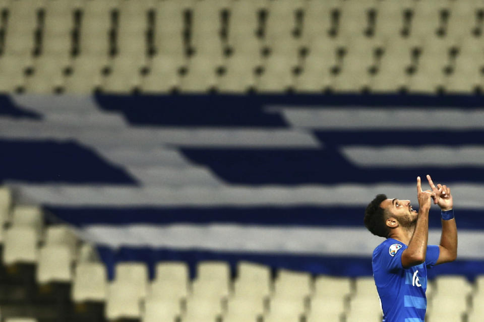 Greece's Vangelis Pavlidis celebrates his goal against Bosnia during the Euro 2020 group J qualifying soccer match between Greece and Bosnia-Herzegovina at the Olympic stadium of Athens, Tuesday, Oct. 15, 2019. (AP Photo/Petros Giannakouris)