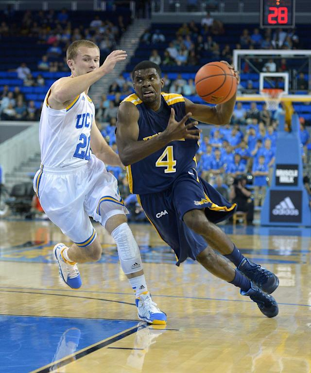 Drexel guard Frantz Massenat, right, drives to the basket as UCLA guard Bryce Alford defends during the first half of an NCAA college basketball game Friday, Nov. 8, 2013, in Los Angeles. (AP Photo/Mark J. Terrill)