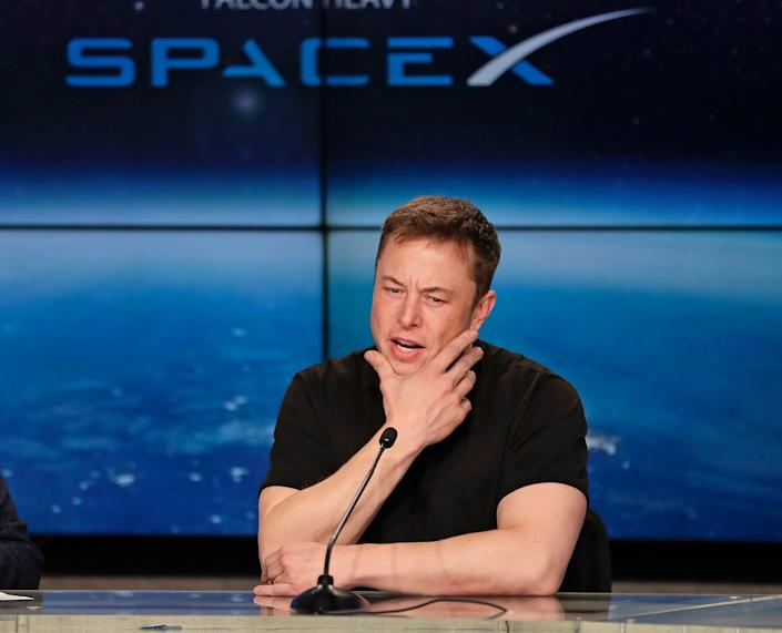 Elon Musk speaks at a SpaceX briefing.