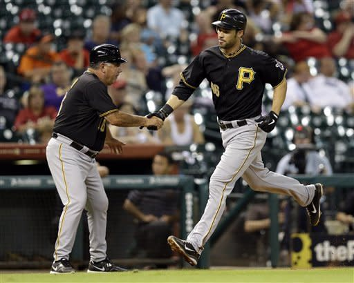 Pittsburgh Pirates' Garrett Jones, right, is congratulated by third base coach Nick Leyva, left, after hitting a home run during the eighth inning of a baseball game against the Houston Astros, Friday, Sept. 21, 2012, in Houston. (AP Photo/David J. Phillip)
