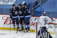 Winnipeg Jets' Dominic Toninato (21), Mason Appleton (22) and Adam Lowry (17) celebrate Appleton's goal against Toronto Maple Leafs goaltender Jack Campbell (36) during the second period of an NHL hockey game Friday, May 14, 2021, in Winnipeg, Manitoba. (John Woods/The Canadian Press via AP)