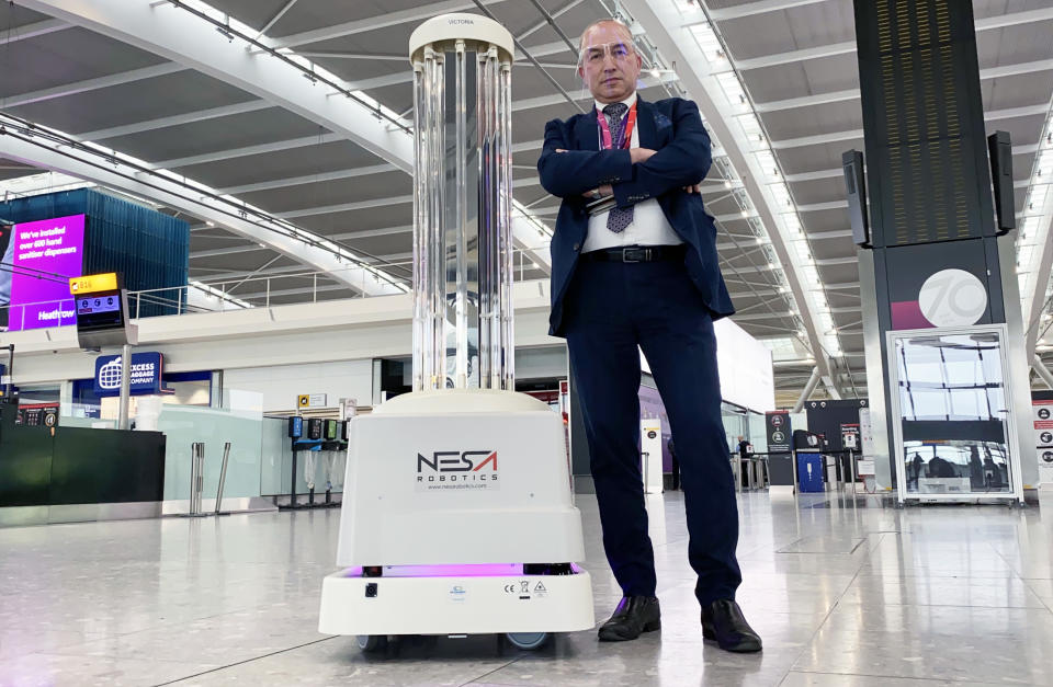 Stan (Duty Manager for Mitie - Hygiene Services at Heathrow) and Victoria (UVD Robot) on Heathrow: Britain's Busiest Airport. (ITV)