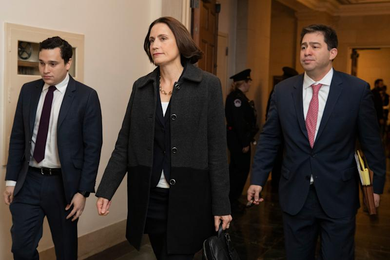Former White House national security aide Fiona Hill, center, arrives to testify before the House Intelligence Committee on Capitol Hill in Washington, Thursday, Nov. 21, 2019.