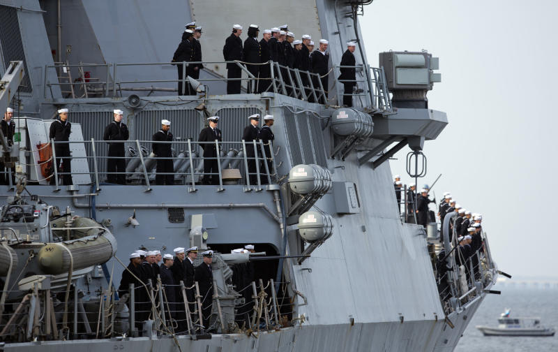 Sailors man the rails aboard the guided -missile destroyer USS Barry as the ship depart the Norfolk Naval Station, Thursday morning, Feb. 7, 2013 for a 6-month deployment. The USS Barry has deployed to Europe to protect U.S. allies from ballistic missiles. (AP Photo/TheVirginian-Pilot,Bill Tiernan) MAGS OUT