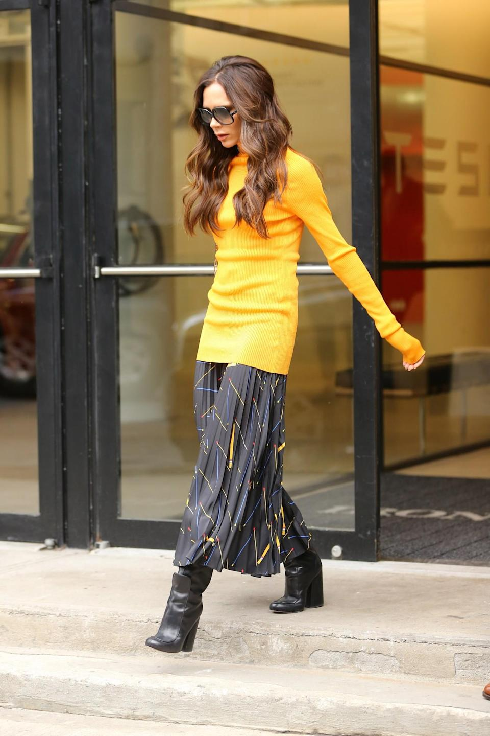 <p>Highlighting her tiny waist in a form-fitting roll neck and printed midi skirt, this look is definitely one we'll recreate. <em>[Photo: Getty]</em> </p>