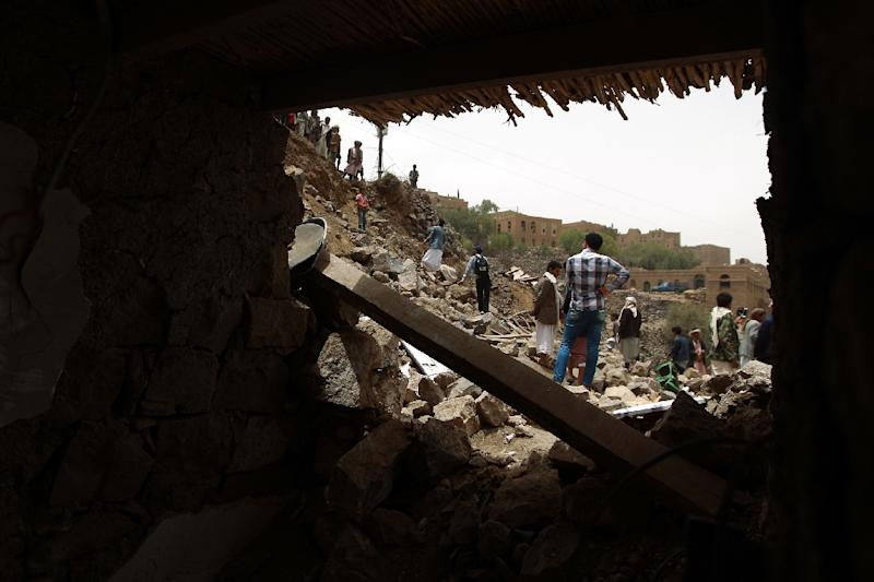 Yemenis inspect the rubble of destroyed houses in the village of Bani Matar on April 4, 2015, a day after it was reportedly hit by a Saudi-led coalition airstrike (AFP Photo/Mohammed Huwais)