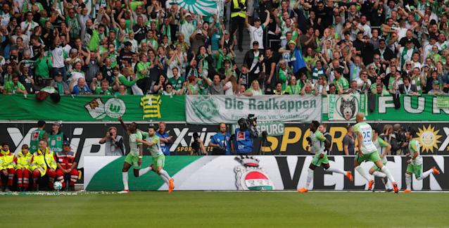 Soccer Football - Bundesliga - VfL Wolfsburg v FC Cologne - Volkswagen Arena, Wolfsburg, Germany - May 12, 2018 Wolfsburg's Josuha Guilavogui celebrates scoring their first goal REUTERS/Wolfgang Rattay DFL RULES TO LIMIT THE ONLINE USAGE DURING MATCH TIME TO 15 PICTURES PER GAME. IMAGE SEQUENCES TO SIMULATE VIDEO IS NOT ALLOWED AT ANY TIME. FOR FURTHER QUERIES PLEASE CONTACT DFL DIRECTLY AT + 49 69 650050