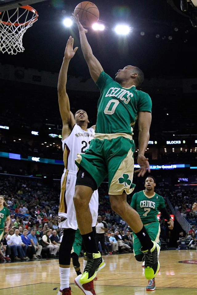 Boston Celtics guard Avery Bradley (0) drives to the basket against New Orleans Pelicans forward Anthony Davis, left, during the first half of an NBA basketball game in New Orleans, Sunday, March 16, 2014. (AP Photo/Jonathan Bachman)