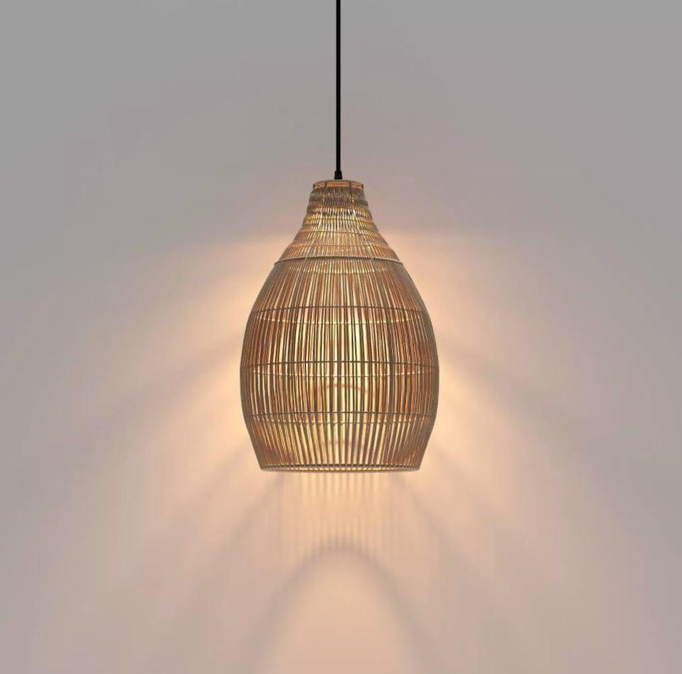 <p>This <span>Opalhouse LED Outdoor Solar Pendant</span> ($90) will look great over a rattan dining set.</p>