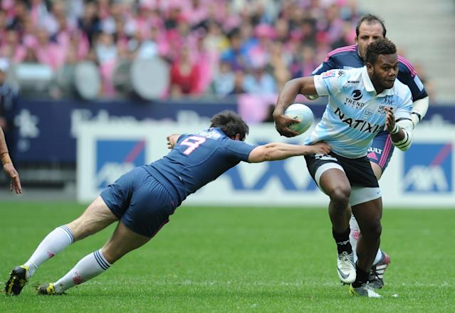 Stade Français' scrum-half Julien Dupuy (L) vies with Racing Metro's Fijian flanker Jone Qovu (R) during the French Top 14 rugby union match Stade Francais vs. Racing Metro on May 5, 2012 at the Charlety stadium in Paris. AFP PHOTO / FRANCK FIFEFRANCK FIFE/AFP/GettyImages