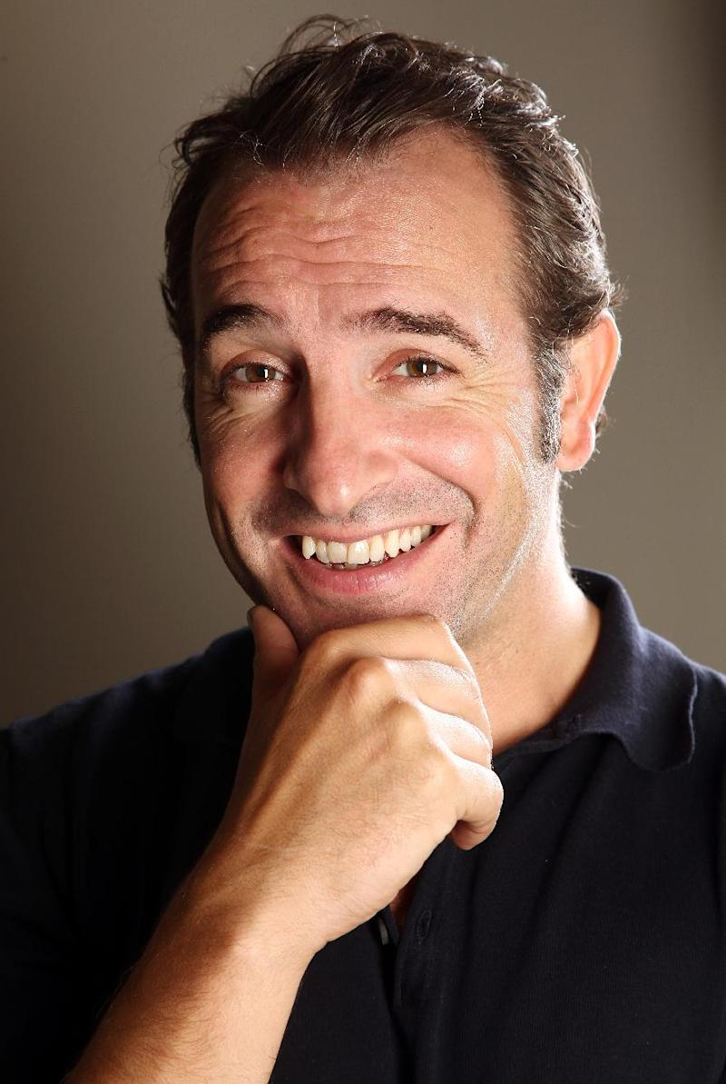 "In this Sept. 12, 2011 photo, actor Jean Dujardin poses for a portrait to promote the film ""The Artist,"" during the 36th Toronto International Film Festival in Toronto, Canada. The film is a black-and-white silent movie about a 1920s Hollywood star whose career crumbles as talkies take over the big screen.  (AP Photo/Carlo Allegri)"