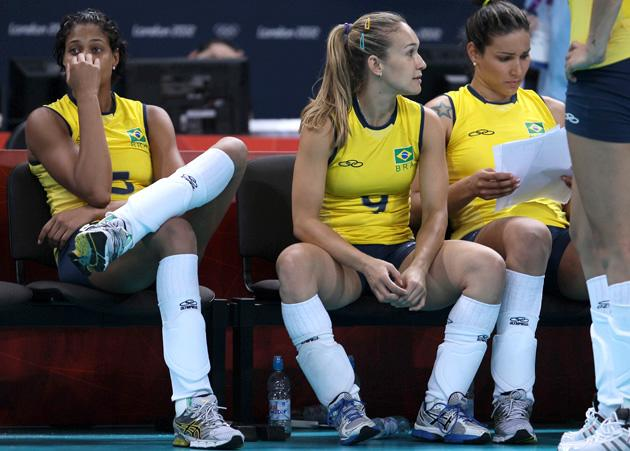 LONDON, ENGLAND - JULY 30:  Fernanda Ferreira of Brazil and team mate Adenizia Silva look on after losing the Women's Volleyball Preliminary match between the United States and Brazil on Day 3 of the London 2012 Olympic Games at Earls Court on July 30, 2012 in London, England.  (Photo by Elsa/Getty Images)