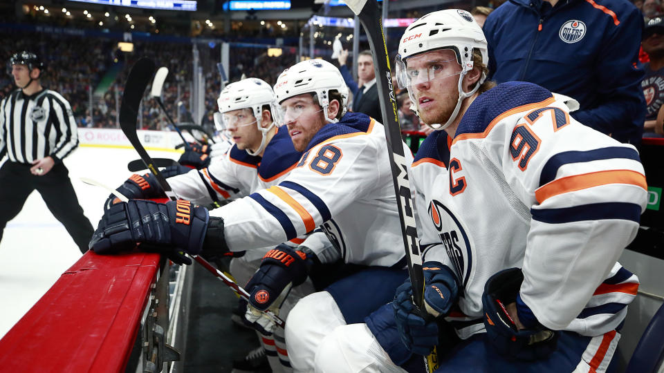 "VANCOUVER, BC - DECEMBER 23: Connor McDavid #97 of the Edmonton Oilers looks on from the bench during their NHL game against the Vancouver Canucks at Rogers Arena December 23, 2019 in Vancouver, British Columbia, Canada.  (Photo by Jeff Vinnick/NHLI via Getty Images)""n"