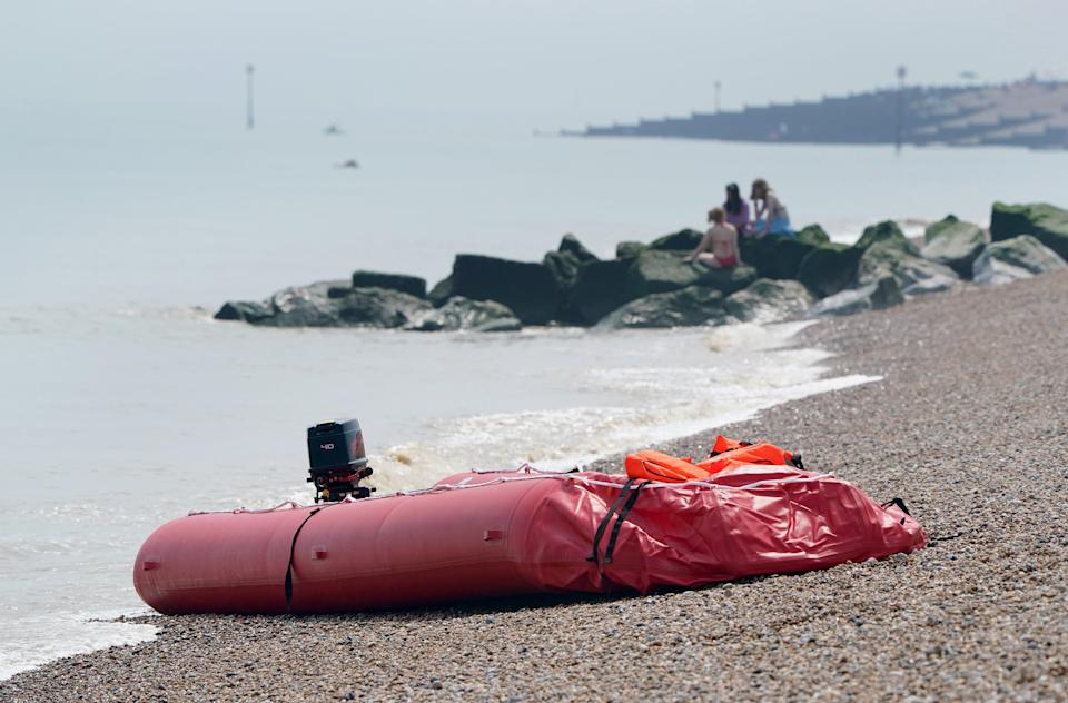 A boat thought to be used in a migrant crossing is left on the beach in Walmer, Kent (Gareth Fuller/PA) (PA Wire)