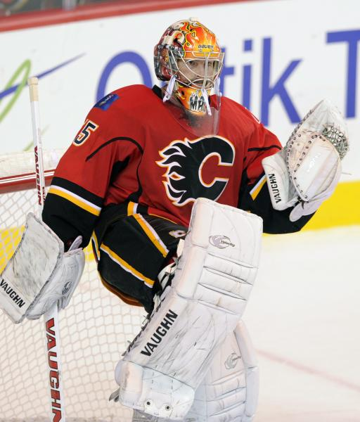 Calgary Flames goalie Joey MacDonald lifts a pad to celebrate a 3-2 victory over the Montreal Canadiens in an NHL hockey game Wednesday, Oct. 9, 2013, in Calgary, Alberta. (AP Photo/The Canadian Press, Larry MacDougal)